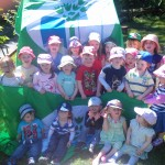 Our pre-schoolers and play group with our 2 green flags